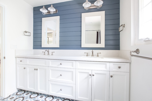 Inspiration for a nautical bathroom in San Diego with shaker cabinets, white cabinets, blue walls, a submerged sink and multi-coloured floors.