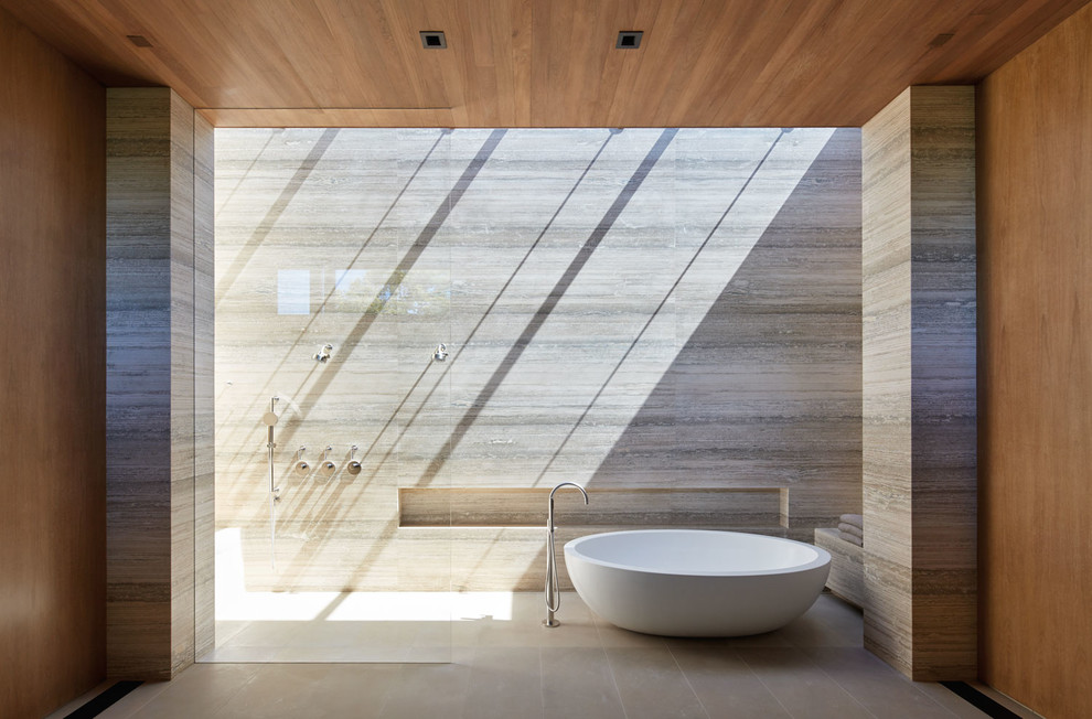 Bathroom - large modern master travertine tile and gray tile limestone floor and beige floor bathroom idea in Other with gray walls