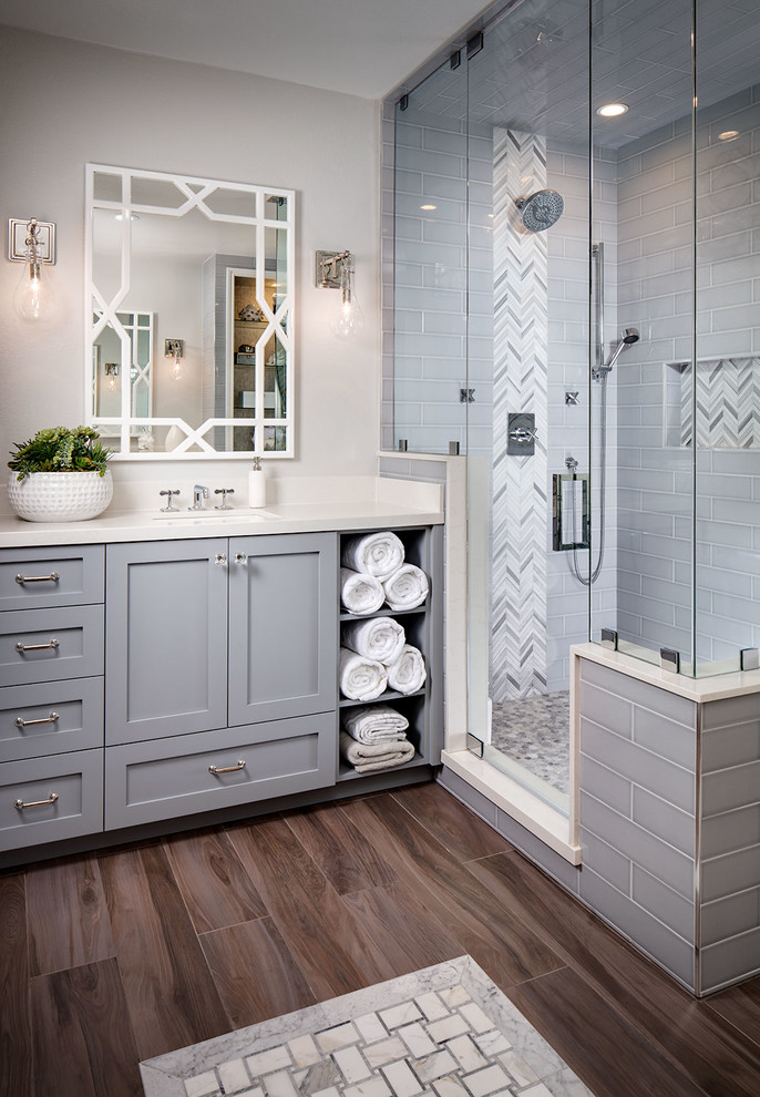 Transitional master gray tile and subway tile medium tone wood floor bathroom photo in San Diego with gray cabinets, gray walls, an undermount sink and a hinged shower door