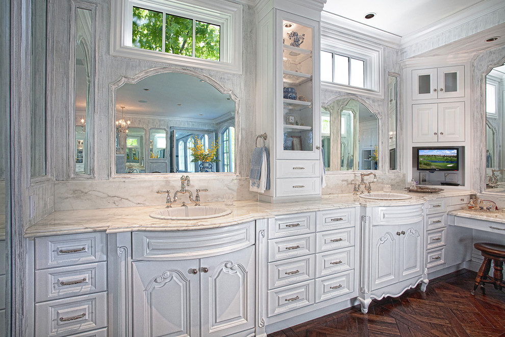Bathroom - traditional bathroom idea in Orange County with a drop-in sink, raised-panel cabinets and white cabinets