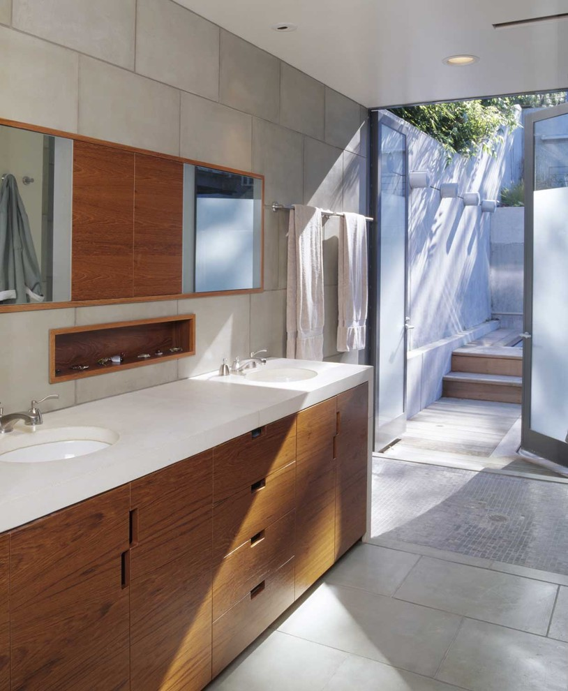 Mid-sized minimalist gray tile and porcelain tile porcelain tile and gray floor walk-in shower photo in San Francisco with flat-panel cabinets, dark wood cabinets, gray walls, an undermount sink and quartzite countertops