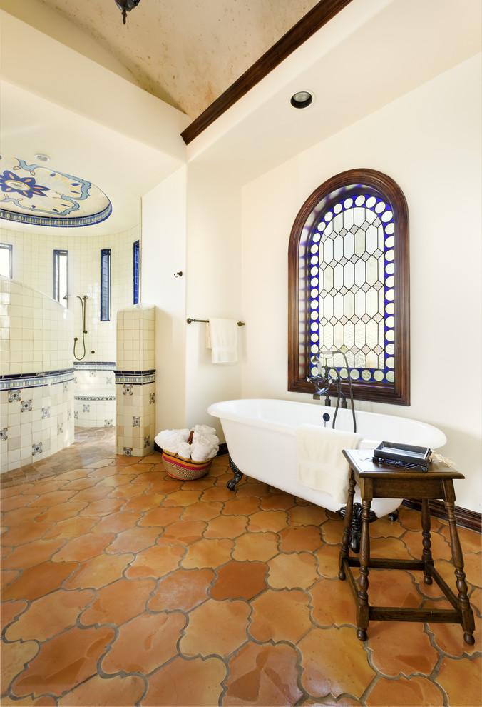Bathroom - mediterranean terra-cotta tile terra-cotta tile bathroom idea in Austin