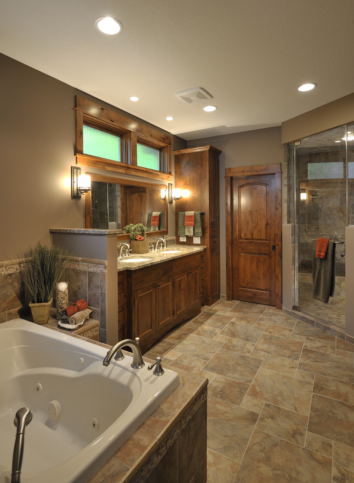 Bathroom - traditional brown tile brown floor bathroom idea in Minneapolis with recessed-panel cabinets and medium tone wood cabinets