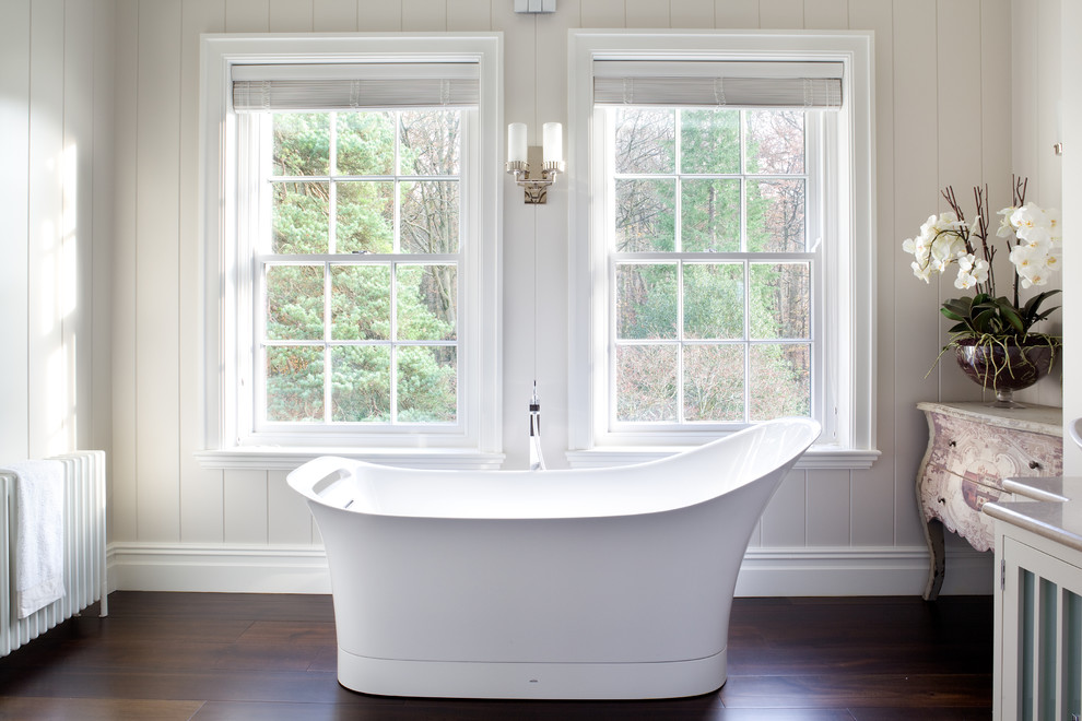 Inspiration for a transitional dark wood floor freestanding bathtub remodel in London
