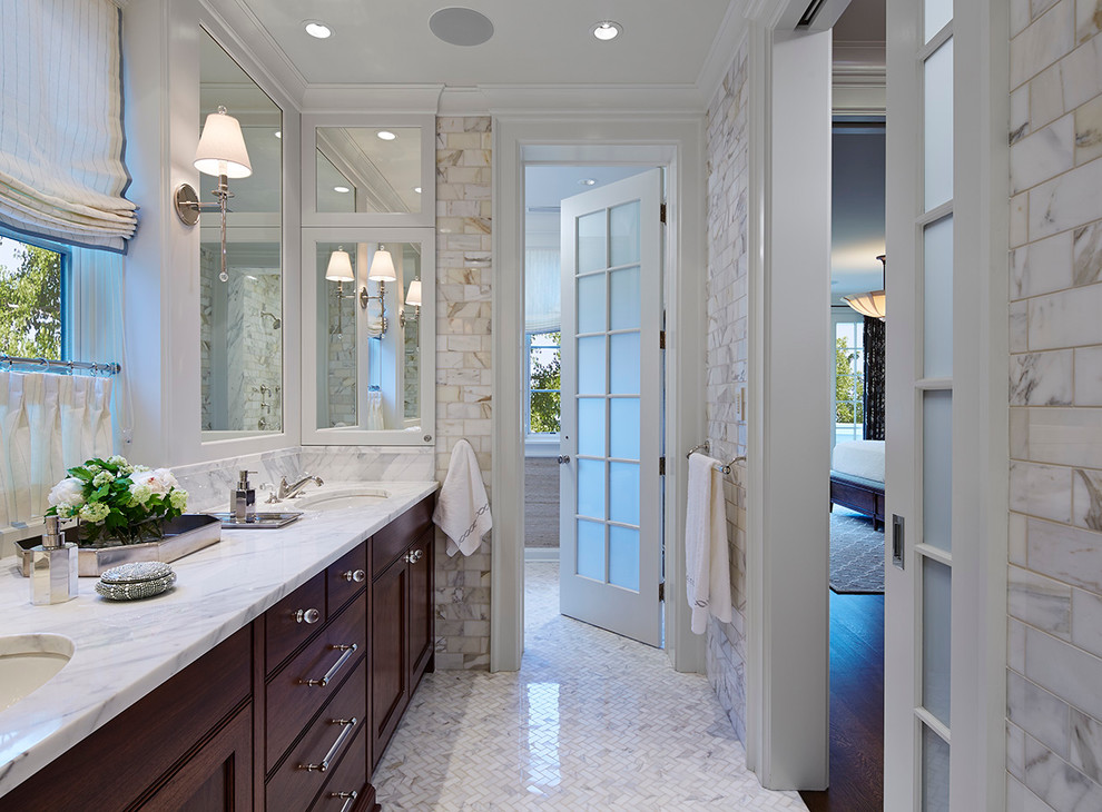 Inspiration for a large timeless master white tile mosaic tile floor bathroom remodel in Chicago with an undermount sink, recessed-panel cabinets, dark wood cabinets and marble countertops