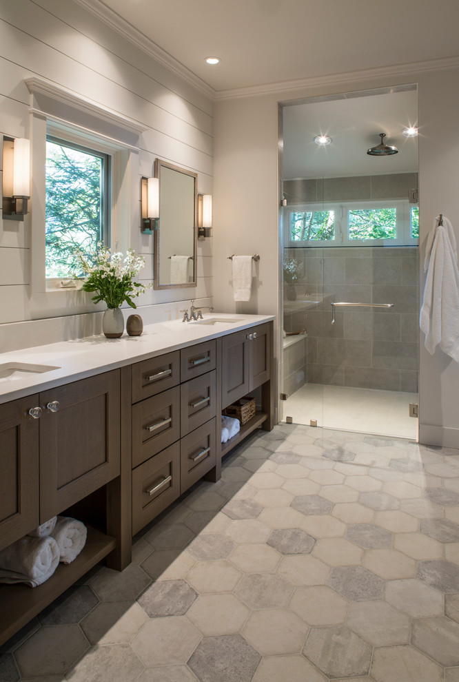 Double shower - mid-sized transitional master gray tile and ceramic tile ceramic tile and gray floor double shower idea in Other with furniture-like cabinets, medium tone wood cabinets, a two-piece toilet, white walls, an undermount sink, quartz countertops, a hinged shower door and white countertops