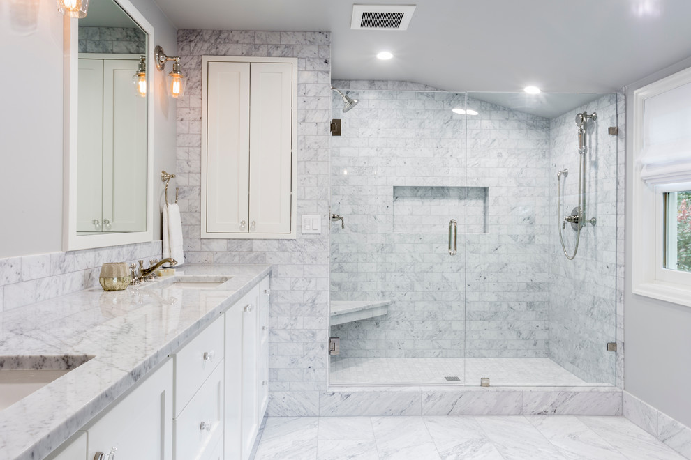 Inspiration for a large transitional master gray tile and marble tile marble floor and gray floor double shower remodel in Portland with shaker cabinets, white cabinets, a two-piece toilet, gray walls, an undermount sink, marble countertops, a hinged shower door and gray countertops