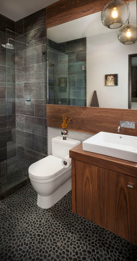 Bathroom - rustic gray tile bathroom idea in San Francisco with a vessel sink, flat-panel cabinets, dark wood cabinets, wood countertops and brown countertops