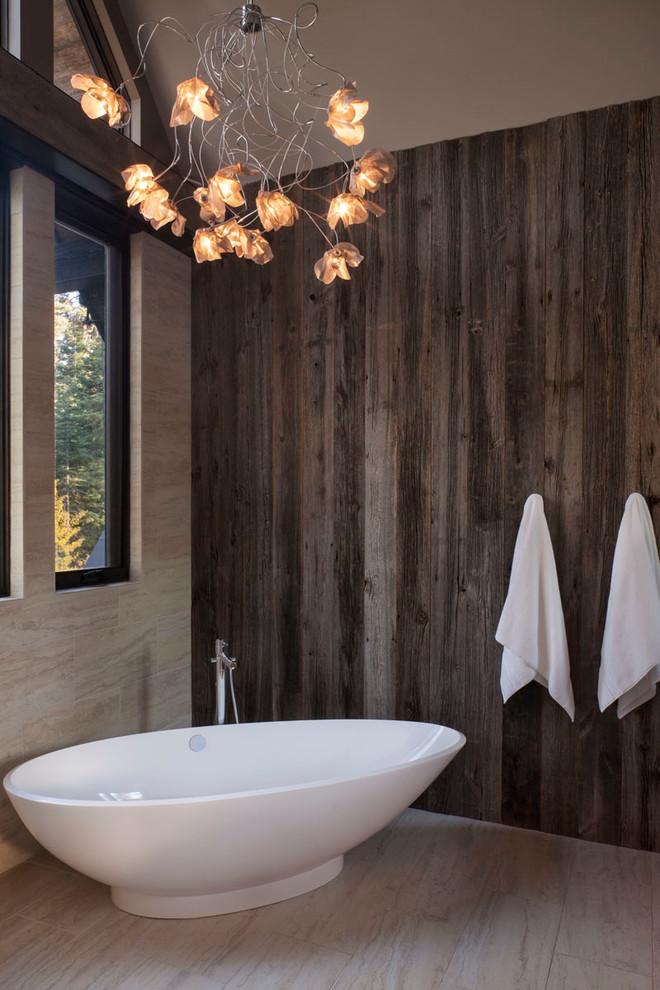 Freestanding bathtub - rustic beige tile freestanding bathtub idea in San Francisco with beige walls