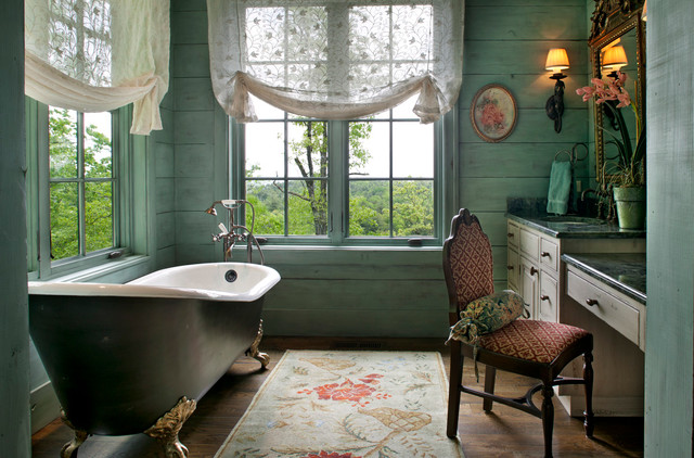 Ornate claw-foot bathtub photo in Other with raised-panel cabinets, blue walls and green countertops