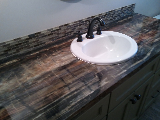 Laminate countertops eclectic bathroom grand rapids by degraaf interiors