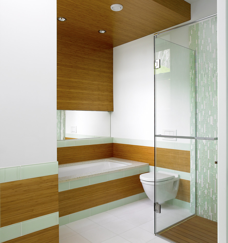 Trendy walk-in shower photo in Vancouver with a wall-mount toilet