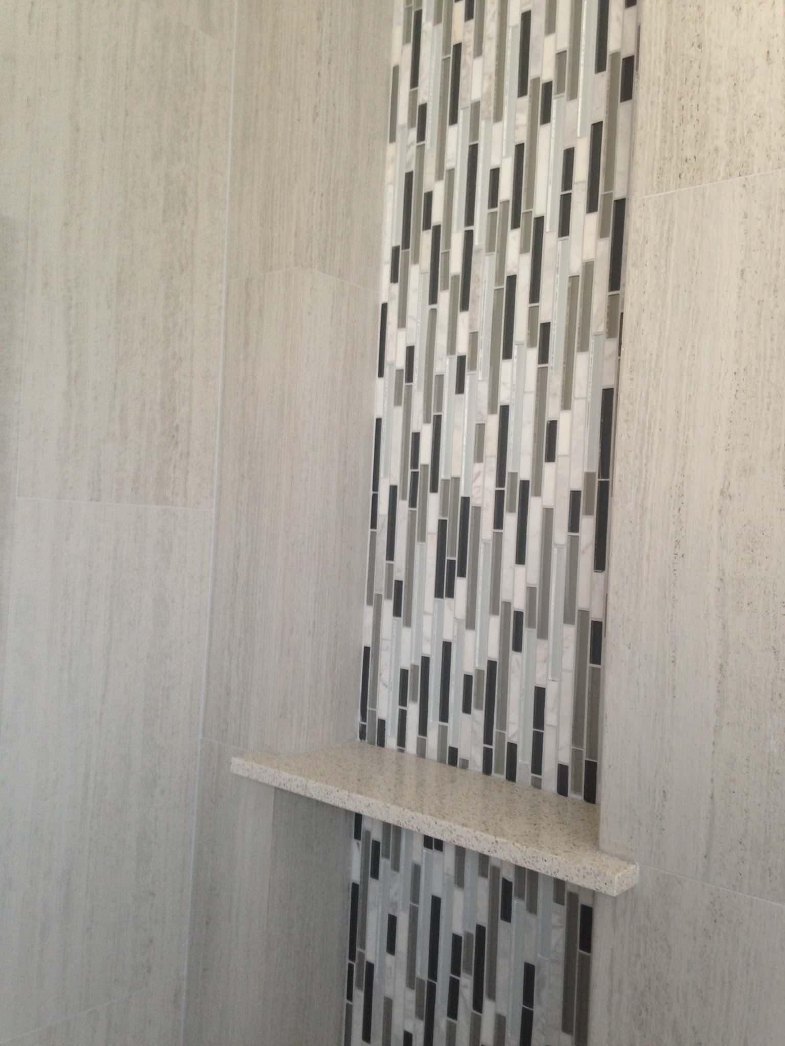 Larger bath shower niche and accent tile