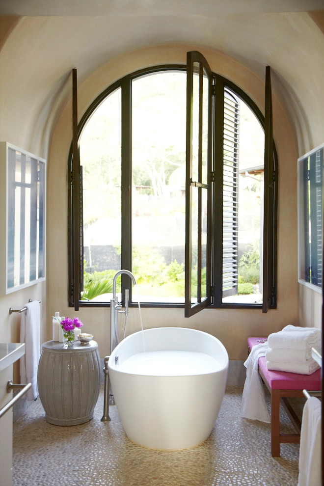 Inspiration for a mediterranean master freestanding bathtub remodel in Other with beige walls