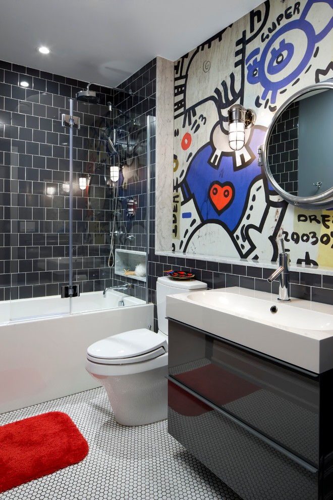 Mid-sized trendy kids' black tile and porcelain tile porcelain tile bathroom photo in Toronto with an integrated sink, multicolored walls, flat-panel cabinets, gray cabinets and a two-piece toilet
