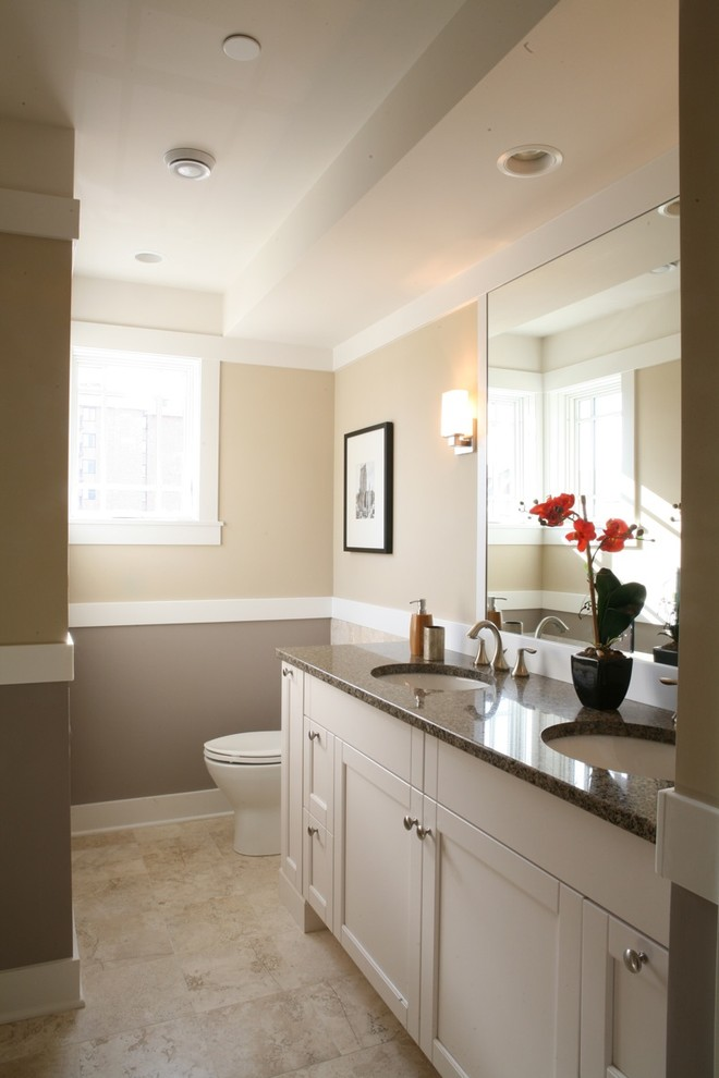 Bathroom - traditional bathroom idea in Chicago with an undermount sink, shaker cabinets and white cabinets