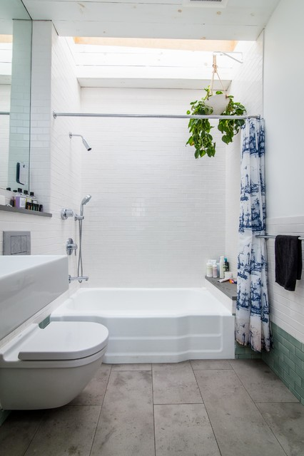 Inspiration for a mid-sized beach style master white tile and ceramic tile ceramic floor bathroom remodel in New York with a wall-mount sink, a wall-mount toilet and white walls