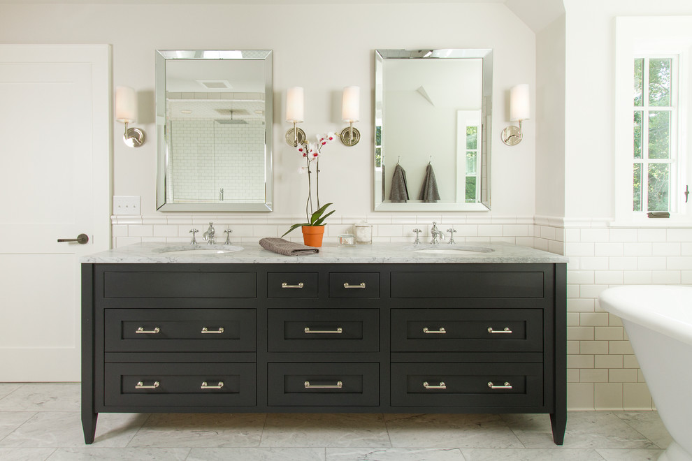 Inspiration for a transitional master bathroom remodel in Minneapolis with an undermount sink, marble countertops and black cabinets