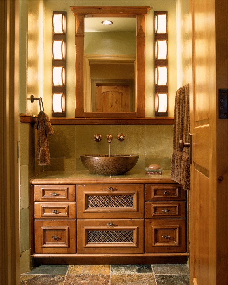 Example of a small transitional 3/4 slate floor and beige floor bathroom design in Denver with tile countertops, a vessel sink, furniture-like cabinets, medium tone wood cabinets and beige walls