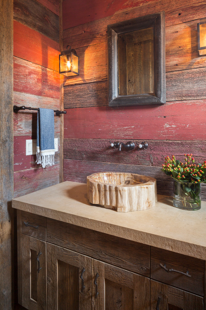 Example of a mountain style bathroom design in Austin with a vessel sink, shaker cabinets, dark wood cabinets and red walls