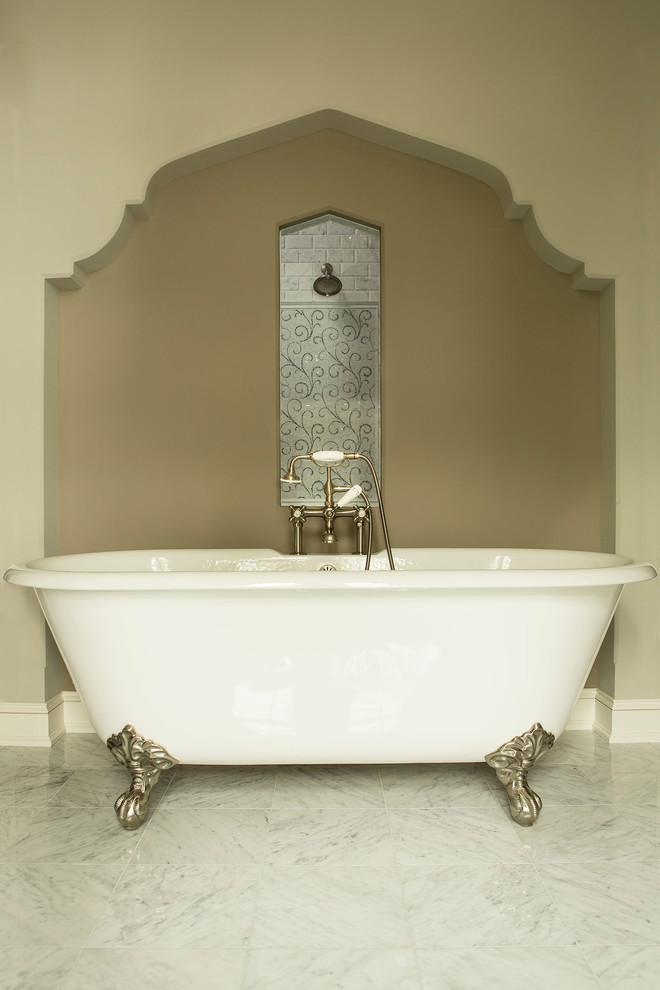 Elegant gray tile marble floor claw-foot bathtub photo in Minneapolis with marble countertops and a two-piece toilet