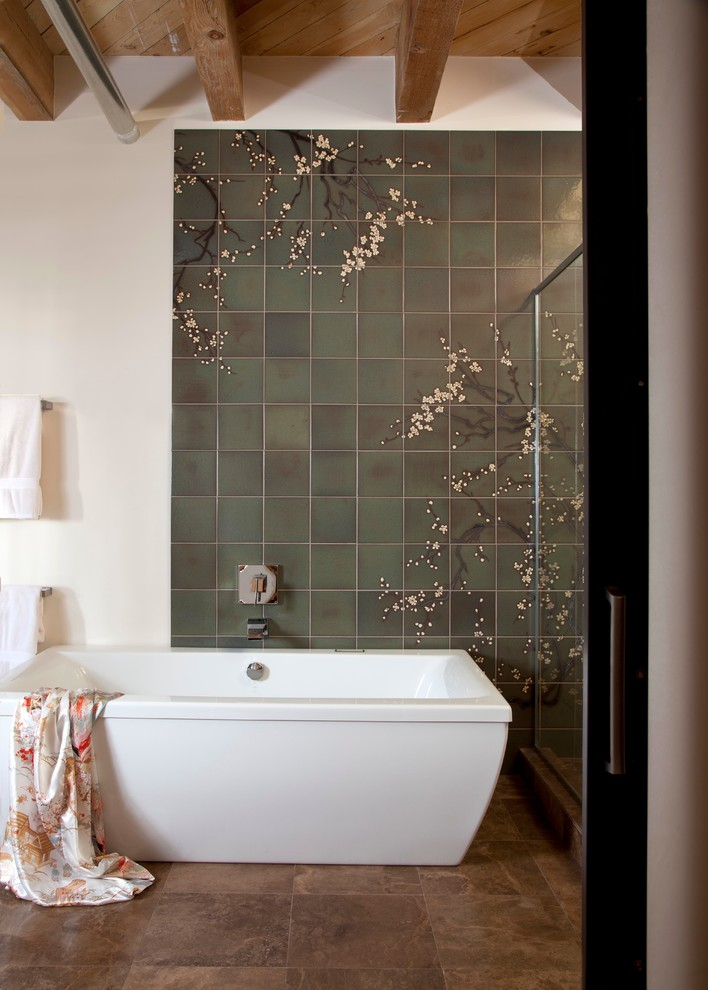 Example of a large trendy master green tile and ceramic tile travertine floor bathroom design in Denver with an undermount sink, flat-panel cabinets, medium tone wood cabinets, marble countertops, a wall-mount toilet and white walls