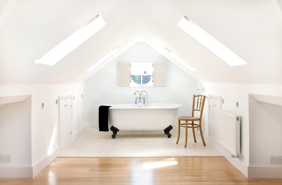 Inspiration for a mid-sized contemporary master ceramic tile claw-foot bathtub remodel in London