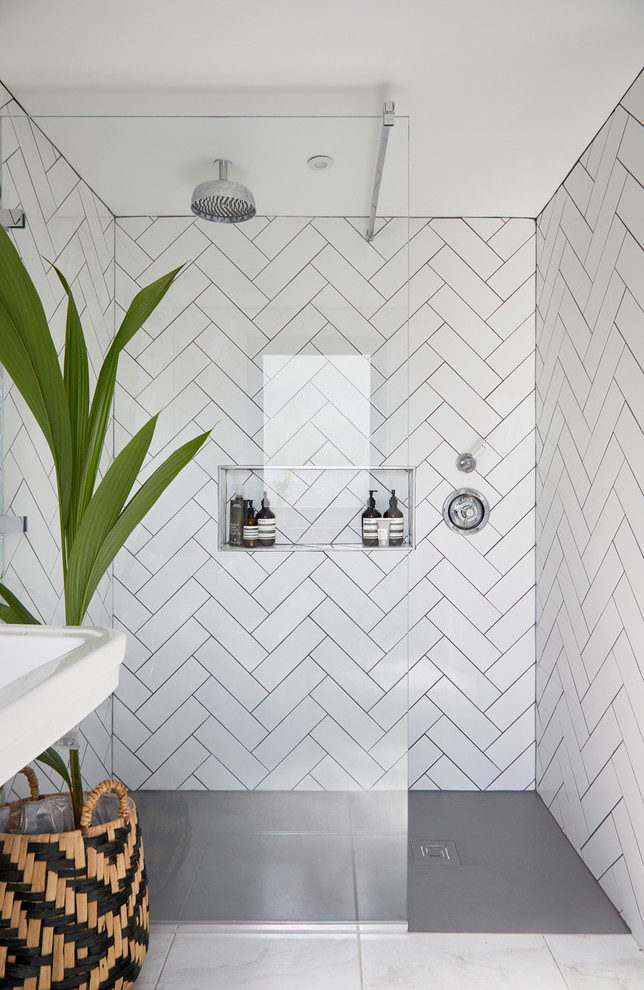 This is an example of a small scandi shower room bathroom in London with white tiles, ceramic tiles and an open shower.