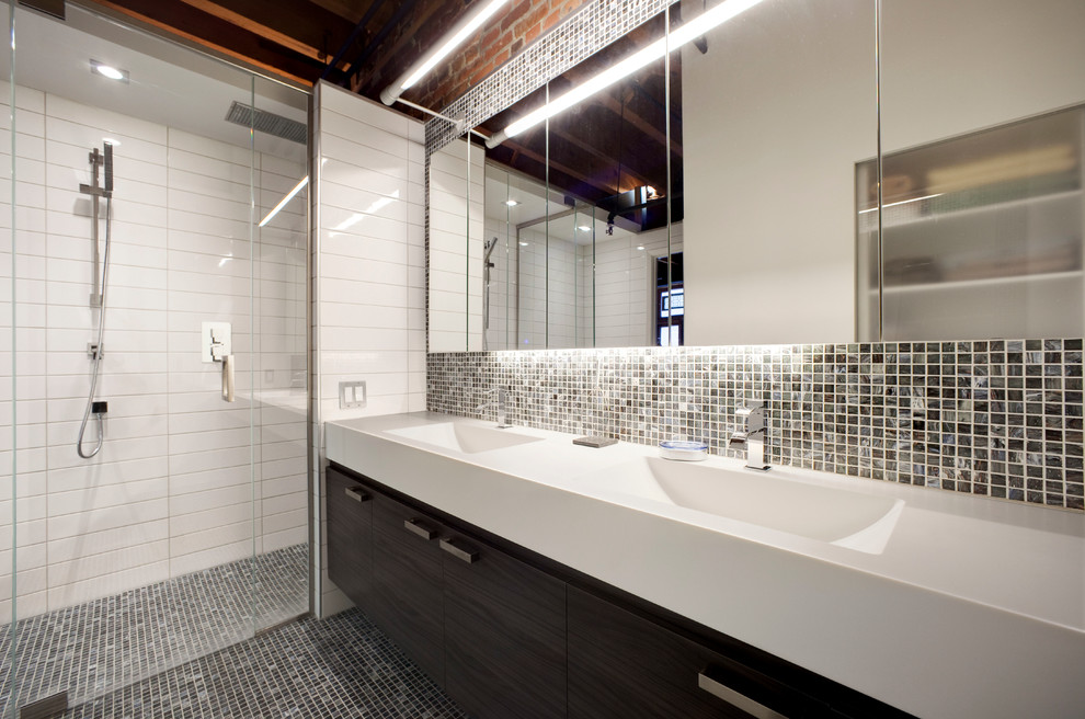 Inspiration for a contemporary black tile alcove shower remodel in Montreal with an integrated sink, flat-panel cabinets and dark wood cabinets