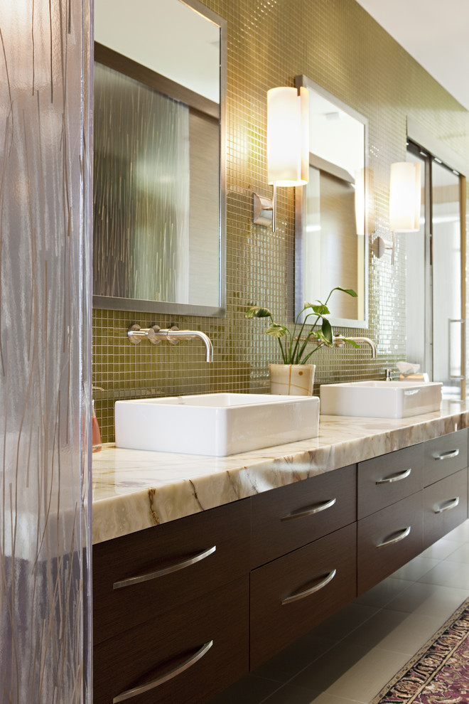 Large trendy gray tile bathroom photo in Salt Lake City with a vessel sink, marble countertops, flat-panel cabinets, green walls and dark wood cabinets