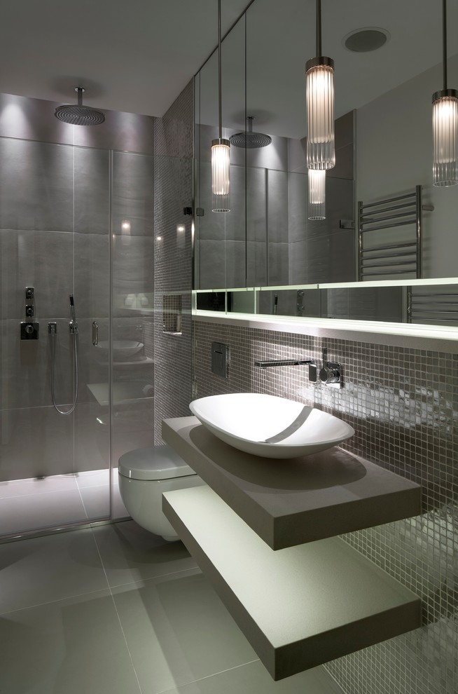Inspiration for a contemporary 3/4 gray tile walk-in shower remodel in London with a vessel sink, open cabinets, gray cabinets, a wall-mount toilet and gray walls