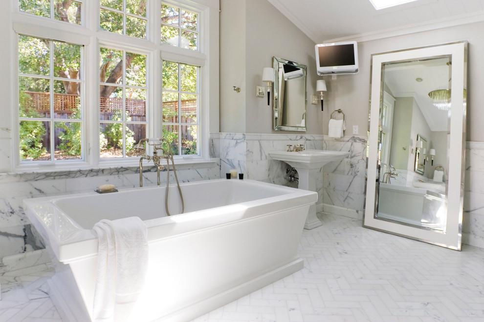 Freestanding bathtub - traditional freestanding bathtub idea in San Francisco with a pedestal sink