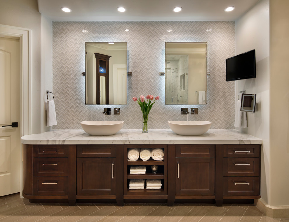 Example of a transitional white tile bathroom design in San Francisco with a vessel sink, recessed-panel cabinets and dark wood cabinets