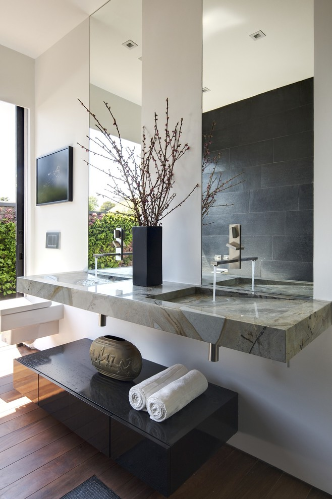 Trendy bathroom photo in Los Angeles with marble countertops