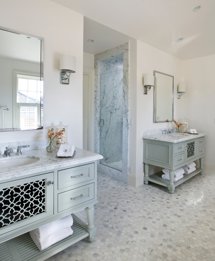 Large trendy master marble floor and white floor bathroom photo in San Francisco with an undermount sink, furniture-like cabinets, white walls, a hinged shower door, gray cabinets and marble countertops