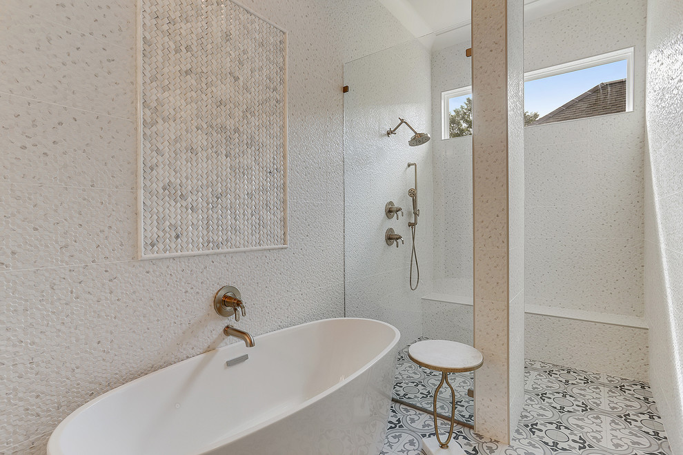 Example of a large transitional master white tile cement tile floor and multicolored floor bathroom design in New Orleans with white cabinets, shaker cabinets, an undermount sink, marble countertops, white countertops and white walls