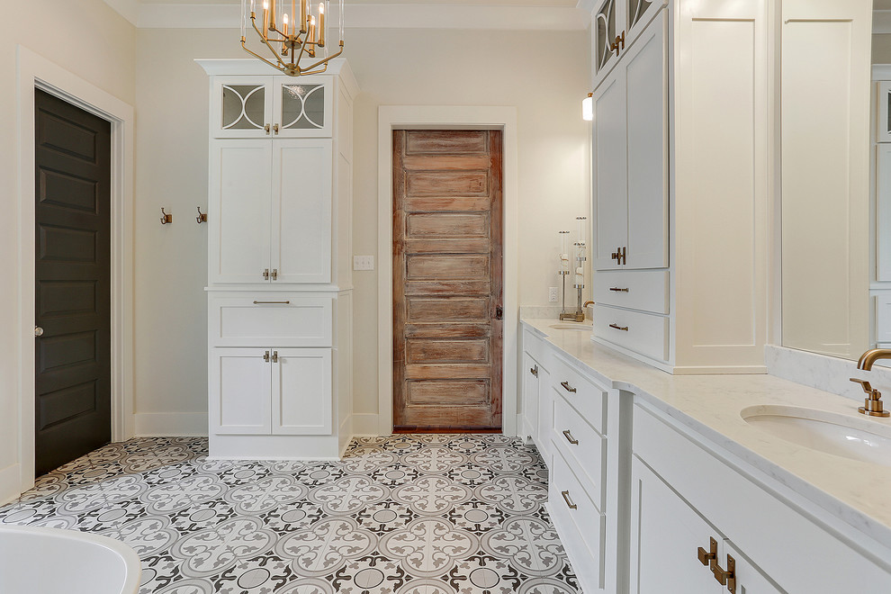 Large transitional master white tile cement tile floor and multicolored floor bathroom photo in New Orleans with shaker cabinets, white cabinets, white walls, an undermount sink, marble countertops and white countertops