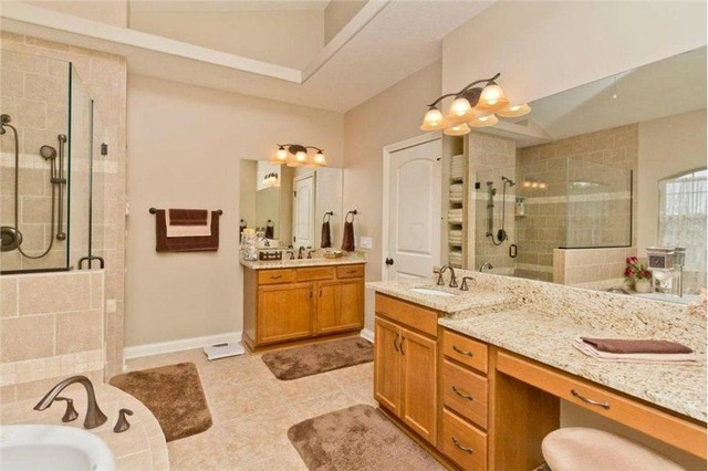 Inspiration for a large timeless master beige tile and ceramic tile ceramic floor bathroom remodel in Columbus with an undermount sink, recessed-panel cabinets, light wood cabinets, granite countertops, a two-piece toilet and beige walls