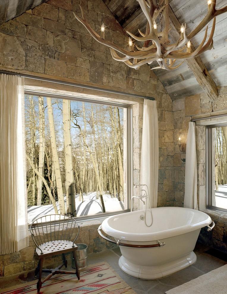 Freestanding bathtub - rustic freestanding bathtub idea in Denver