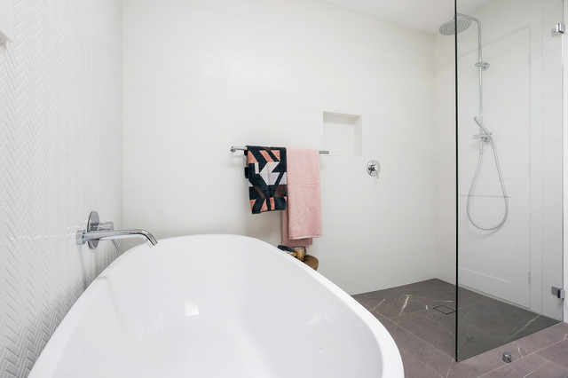 Inspiration for a large contemporary master bathroom in Sydney with shaker cabinets, white cabinets, a freestanding tub, an open shower, a wall-mount toilet, white tile, porcelain tile, white walls, porcelain floors, an integrated sink, engineered quartz benchtops, grey floor, an open shower and white benchtops.