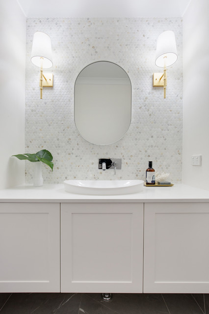 This is an example of a large contemporary master bathroom in Sydney with flat-panel cabinets, white cabinets, multi-coloured tile, marble, an integrated sink and engineered quartz benchtops.