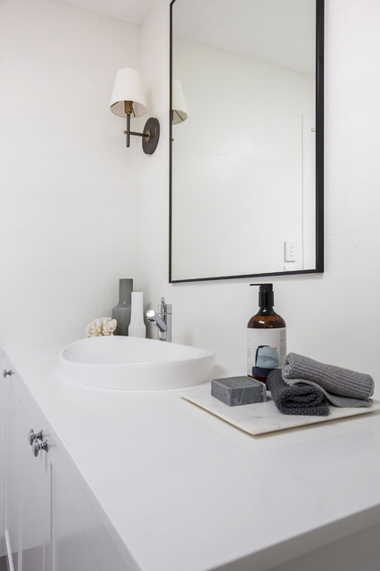 Design ideas for a large contemporary master bathroom in Sydney with shaker cabinets, white cabinets, a freestanding tub, an open shower, a wall-mount toilet, white tile, porcelain tile, white walls, porcelain floors, an integrated sink, engineered quartz benchtops, grey floor, an open shower and white benchtops.