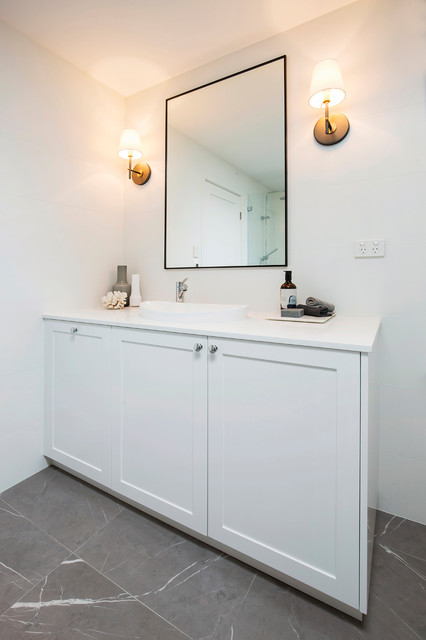 Large contemporary master bathroom in Sydney with shaker cabinets, white cabinets, a freestanding tub, an open shower, a wall-mount toilet, white tile, porcelain tile, white walls, porcelain floors, an integrated sink, engineered quartz benchtops, grey floor, an open shower and white benchtops.