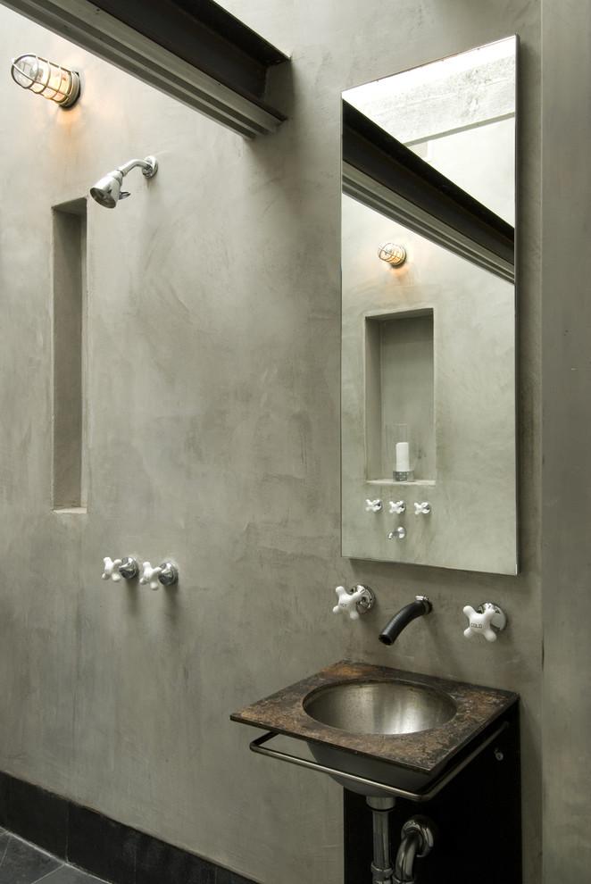 Bathroom - industrial bathroom idea in San Francisco with a wall-mount sink and beige walls