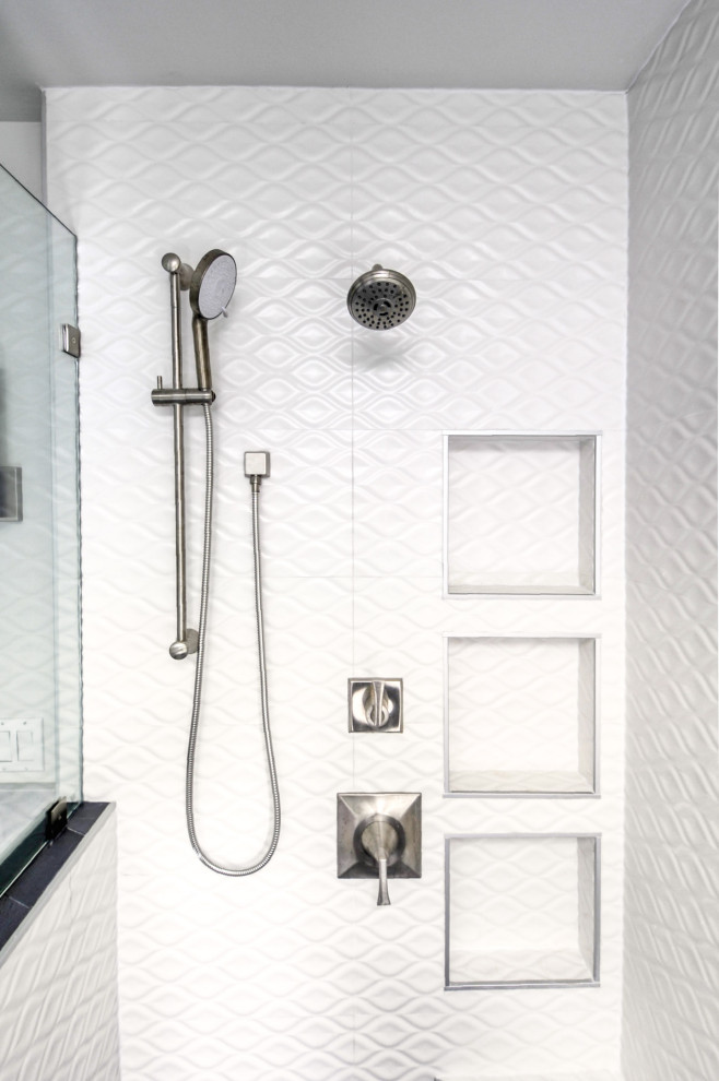 Example of a mid-sized minimalist master white tile and ceramic tile cement tile floor and gray floor bathroom design in DC Metro with recessed-panel cabinets, white cabinets, a two-piece toilet, blue walls, an undermount sink, marble countertops, a hinged shower door and white countertops