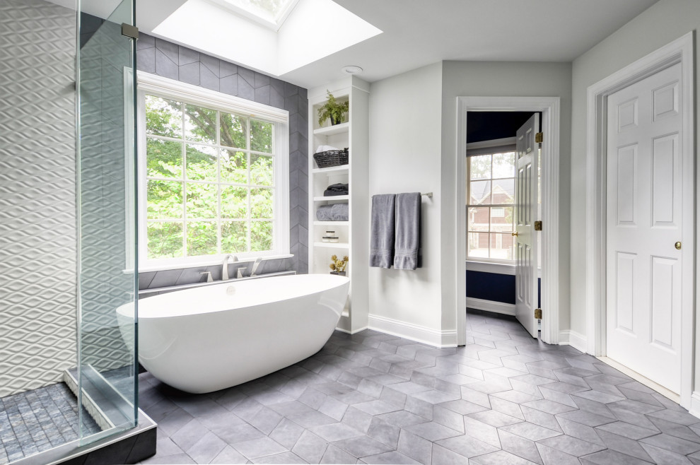 Bathroom - mid-sized modern master white tile and ceramic tile cement tile floor and gray floor bathroom idea in DC Metro with recessed-panel cabinets, white cabinets, a two-piece toilet, gray walls, an undermount sink, marble countertops, a hinged shower door and white countertops