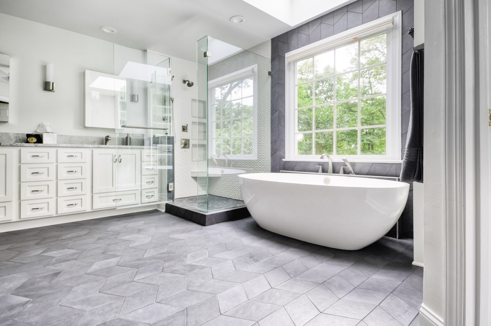 Mid-sized minimalist master white tile and ceramic tile cement tile floor and gray floor bathroom photo in DC Metro with recessed-panel cabinets, white cabinets, a two-piece toilet, gray walls, an undermount sink, marble countertops, a hinged shower door and white countertops