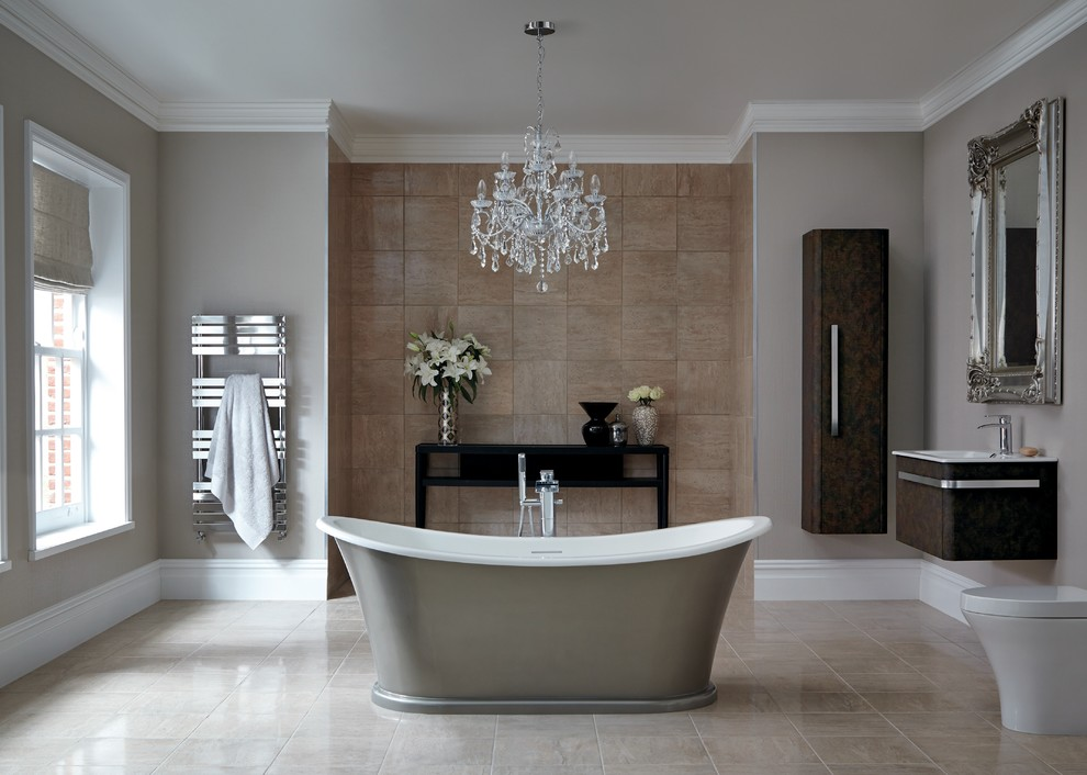 Huge elegant master brown tile freestanding bathtub photo in Hertfordshire with a wall-mount sink, flat-panel cabinets, dark wood cabinets, a one-piece toilet and gray walls