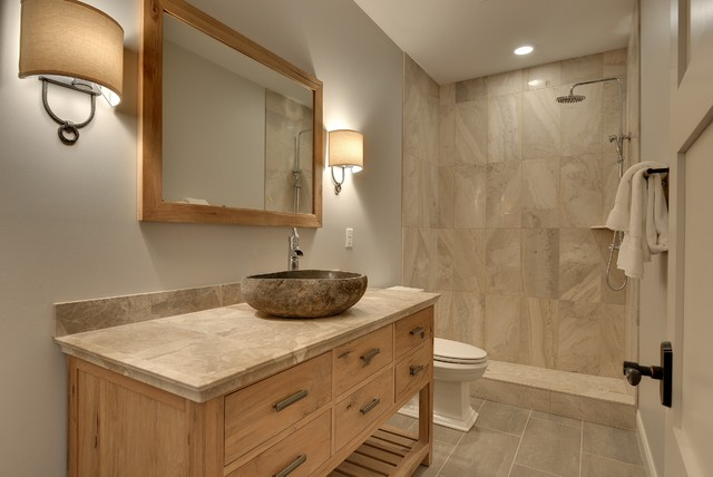 Example of a mid-sized transitional 3/4 gray tile and stone tile ceramic floor bathroom design in Minneapolis with a vessel sink, furniture-like cabinets, light wood cabinets, tile countertops, a two-piece toilet and gray walls
