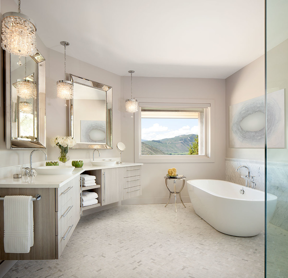 Example of a large transitional master white tile and mosaic tile mosaic tile floor bathroom design in Denver with light wood cabinets, marble countertops, a vessel sink, flat-panel cabinets and beige walls